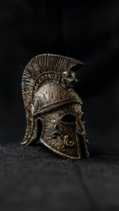 old spartan helmet with ornament on black background