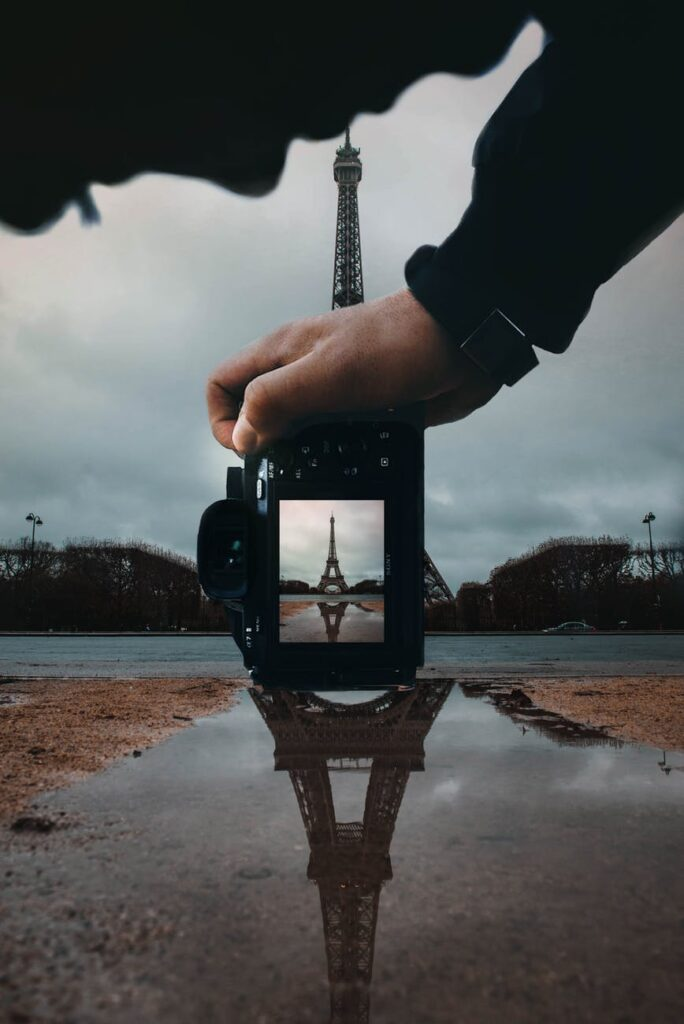 photo of person holding dslr camera