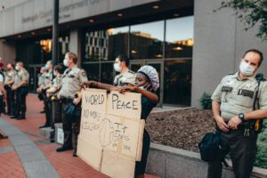 person protesting next to cops
