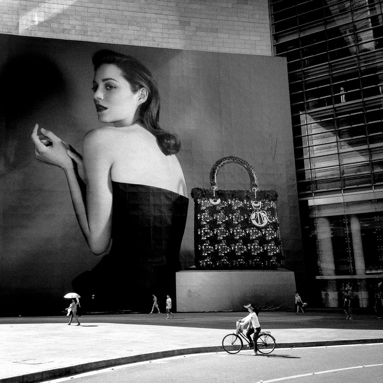 woman wearing black tube dress painting