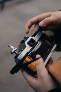 professional vintage film camera in hands