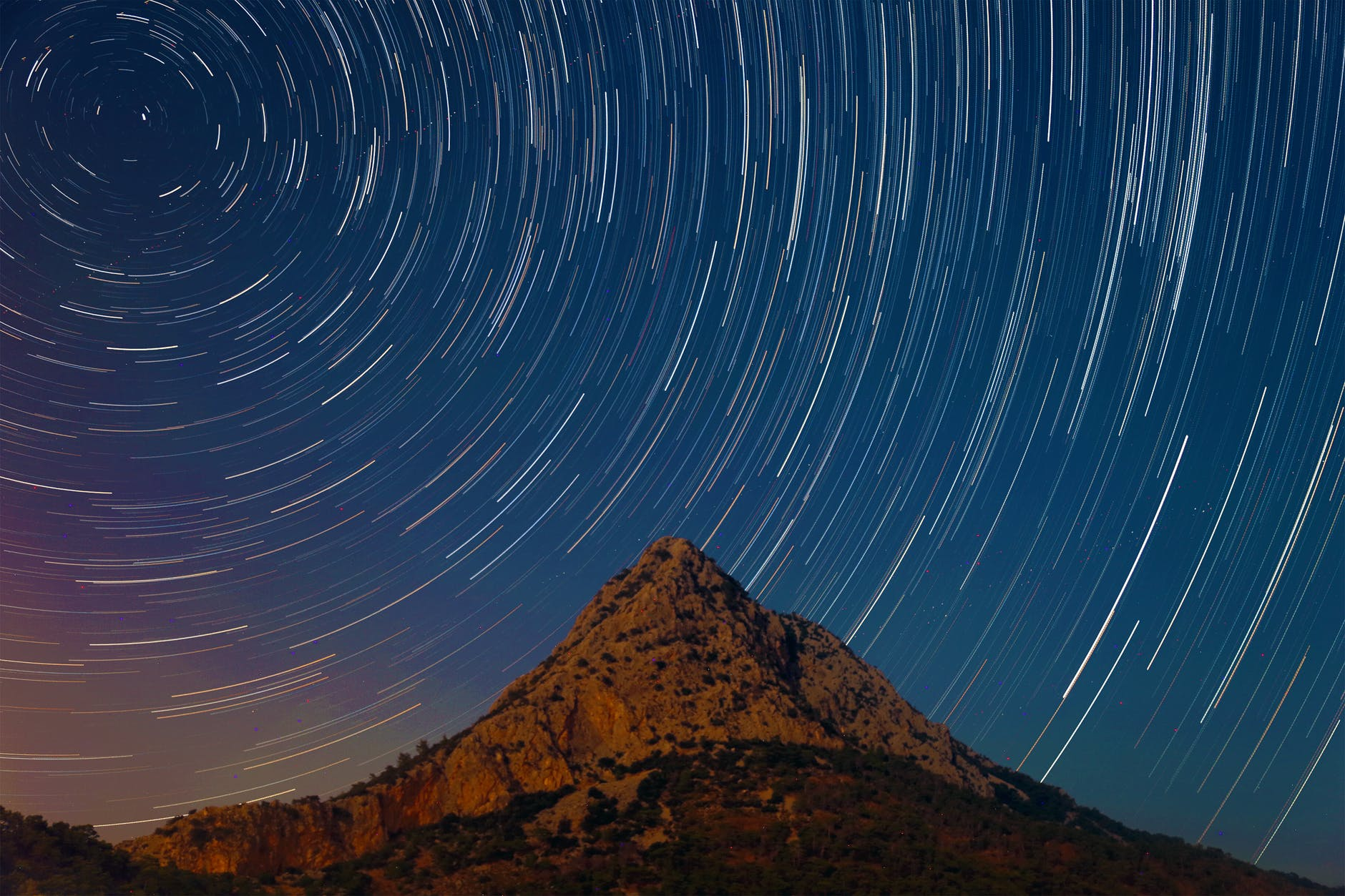 mountain under a starry sky in timelapse mode